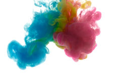 Colors dropped into liquid and photographed while in motion. Ink shape or swirling in water for design or decorate background or a Royalty Free Stock Image