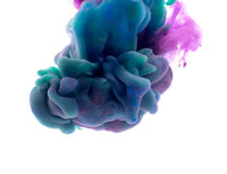 Colors dropped into liquid and photographed while in motion. Ink shape or swirling in water for design or decorate background or a Stock Photography