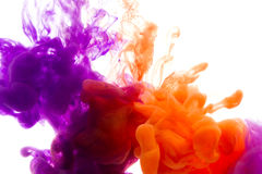 Colors dropped into liquid and photographed while in motion. Ink shape or swirling in water for design or decorate background or a. Bstract banner on white stock photography