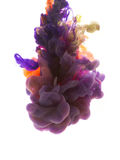Colors dropped into liquid and photographed while in motion. Ink shape or swirling in water for design or decorate background or a Stock Image