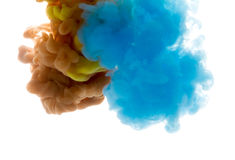 Colors dropped into liquid and photographed while in motion. Ink Royalty Free Stock Photos