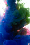Colors dropped into liquid and photographed while in motion. Ink Royalty Free Stock Photo