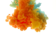 Colors dropped into liquid and photographed while in motion. Ink Royalty Free Stock Photography