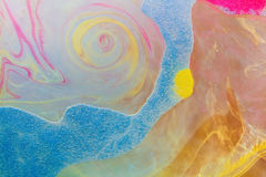 Colors dropped into liquid and photographed while in motion. Ink Royalty Free Stock Images
