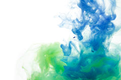 Colors dropped into liquid and photographed while in motion. Ink Stock Images