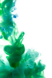 Colors dropped into liquid and photographed while in motion. Ink Stock Image