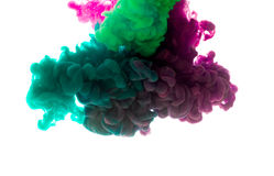 Colors dropped into liquid and photographed while in motion. Ink Stock Photos