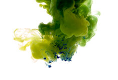 Colors dropped into liquid and photographed while in motion. Ink Royalty Free Stock Image