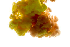 Colors dropped into liquid and photographed while in motion. Ink Stock Photography