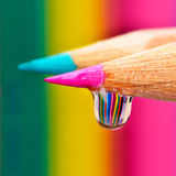 Colors explosion on a drop. Refraction of colored pencils on a drop Royalty Free Stock Photos