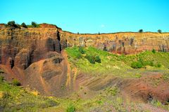 The colors of extinct vulcano of Racos Brasov, Romania, Heghes Peak. Volcanic rock Transylvania Ardeal cliff stone sky mining exploitation canyon beautiful stock image