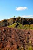 The colors of extinct vulcano of Racos Brasov, Romania, Heghes Peak. Volcanic rock Transylvania Ardeal cliff stone sky mining exploitation canyon beautiful royalty free stock photography