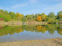 Colors of fall - reflections in a lake Royalty Free Stock Photo