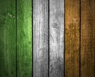 Irish flag on wood background. The colors of the flag of Ireland on a wood background royalty free stock photos