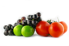 Colors of Fruit. Fruit and vegetables on a isolated white background Royalty Free Stock Photos