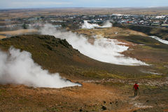 Colors of Iceland. A tourist walks in the middle on newly created minivolcanos royalty free stock images