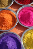 Colors of India. Different vivid colourful powders used in India Stock Images