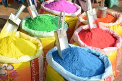 Colors of India. Colorful powders used for religious purposes by Indian people in a special packet. Different colors of powders Royalty Free Stock Photo