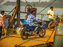 Colors of India. Gokarna Karnataka India December 13, 2017 View of unknowns people traveling in the ferry to Karwar in southern India royalty free stock images