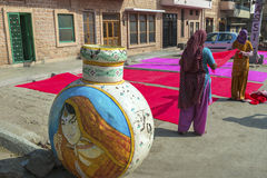 Colors of Jodhpur, India. Women drying the dyed fabric on a sidewalk in Jodhpur, India Stock Photos