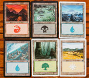 Colors and Lands cards of game Magic The Gathering Stock Image