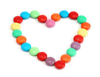 Colors of Love. Heart by colored candy royalty free stock image