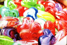 Colors of Love. Glass hearts sold in Seattle. Meant to portray that love can come in any form Royalty Free Stock Photo