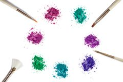 Colors make up eye shadow and brush on white stock photography