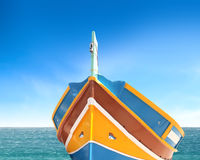 Colors of Malta. Traditional colored boat in the sea of Malta Royalty Free Stock Image