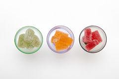 Colors marmalade in wineglass on white  backgrounds Stock Photos