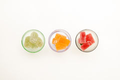 Colors marmalade in wineglass on white  backgrounds Royalty Free Stock Image