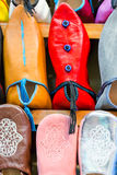 Colors of Marrakesh on sophisticated handmade slippers at medina. Colors of Marrakesh on sophisticated handmade traditional leather slippers at old medina souk Royalty Free Stock Photos
