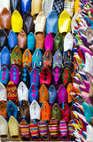Colors of Marrakesh on sophisticated handmade slippers at medina. Colors of Marrakesh on sophisticated handmade traditional leather slippers at old medina souk Royalty Free Stock Image