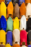 Colors of Marrakesh on sophisticated handmade slippers at medina. Colors of Marrakesh on sophisticated handmade traditional leather slippers at old medina souk Royalty Free Stock Photography