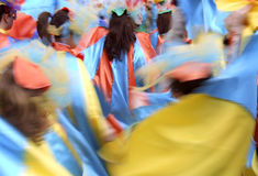 Colors in motion. Colors and people in motion during a party in the street Stock Images