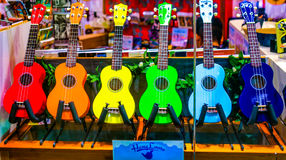 Colors of Music in Hawaii. Waikiki, Hawaii, USA - Sept. 4, 2015:  A music store in Hawaii displays colorful ukuleles in the storefront window Stock Images