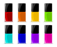 Colors of nail lacquers contained in transparent bottles Royalty Free Stock Images