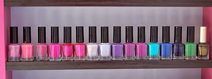 Colors nail polishes. Different color nail polishes pink purple white green blue sparkle Royalty Free Stock Photography