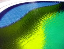 Colors over tiles in a pool Stock Photography