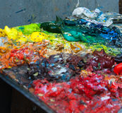 Colors on a palette. A chaotic bunch of squeezed colors on the palette of a street painter in Paris Stock Photos