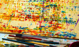 Colors in the palette of the painter and used brushes to paint t Royalty Free Stock Image