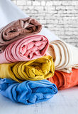 Colors pants on wooden table Royalty Free Stock Photography