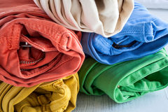 Colors pants on wooden table Stock Photography