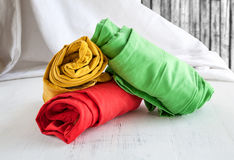 Colors pants on wooden table Stock Photos