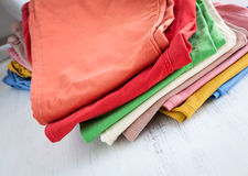 Colors pants on wooden table Royalty Free Stock Photos