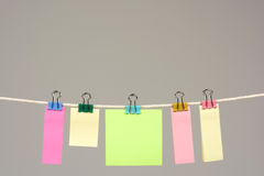 Colors paper on washing line Royalty Free Stock Image