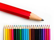 Colors pencil - education statistics. Colors pencil over white in a statistics graph composition Royalty Free Stock Photos