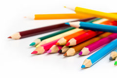 Colors pencil - education statistics. Colors pencil over white in a statistics graph composition Royalty Free Stock Images