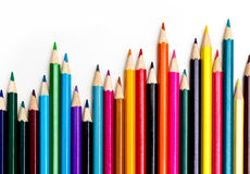 Colors pencil - education statistics. Colors pencil over white in a statistics graph composition Stock Image