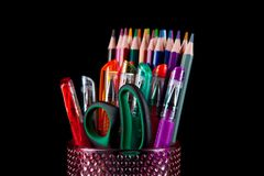 Colors pencil in glass with back background Royalty Free Stock Photography